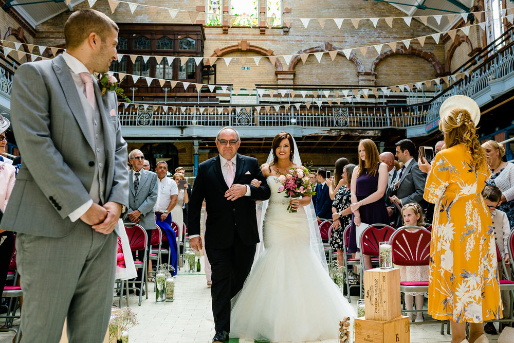 A Victoria Baths wedding ceremony, Kirsty walks down the aisle to greet Kirk.