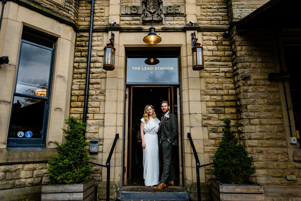 The Lead Station, a wedding venue in Chorlton Manchester, Rose & Josh standing in the doorway.