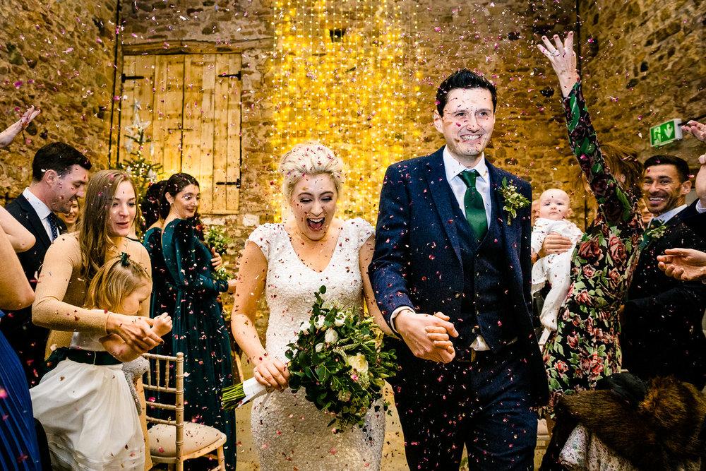 Wedding confetti inside Eden Barn Cumbria by wedding photographers Zoe & Tom