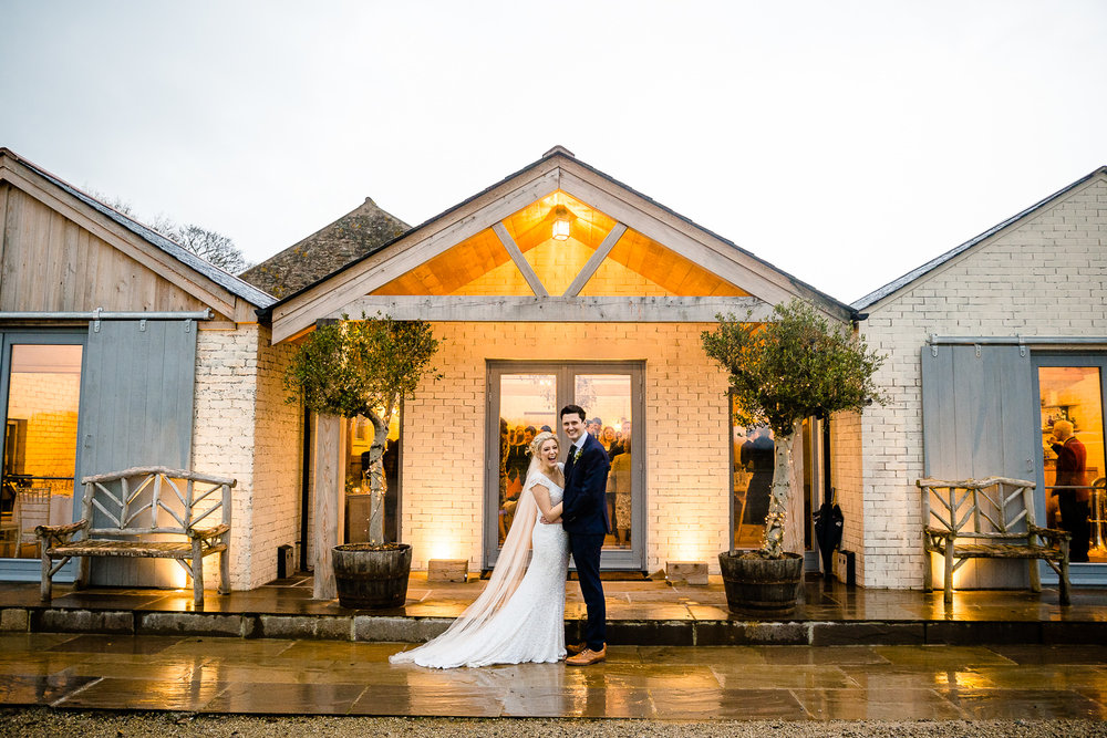A bride and groom outside Eden Barn, Wedding Photography