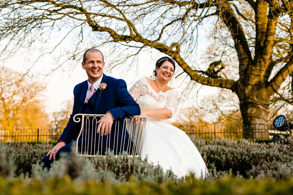 Kate and Paul sat laughing together, Iscoyd Park Wedding Potography