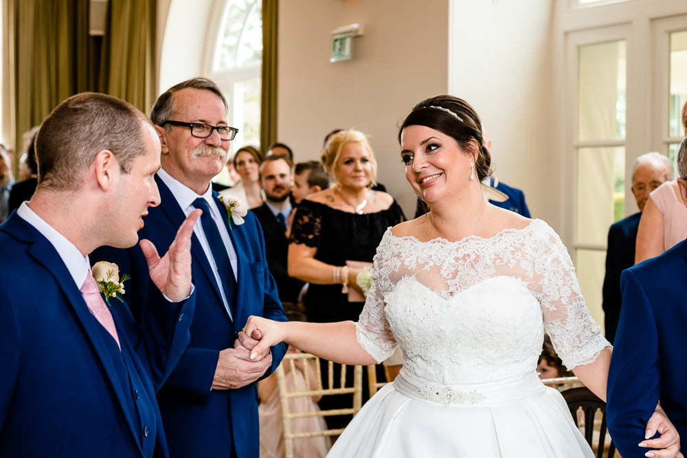 A bride sees her groom for the first time at a Iscoyd Park Wedding