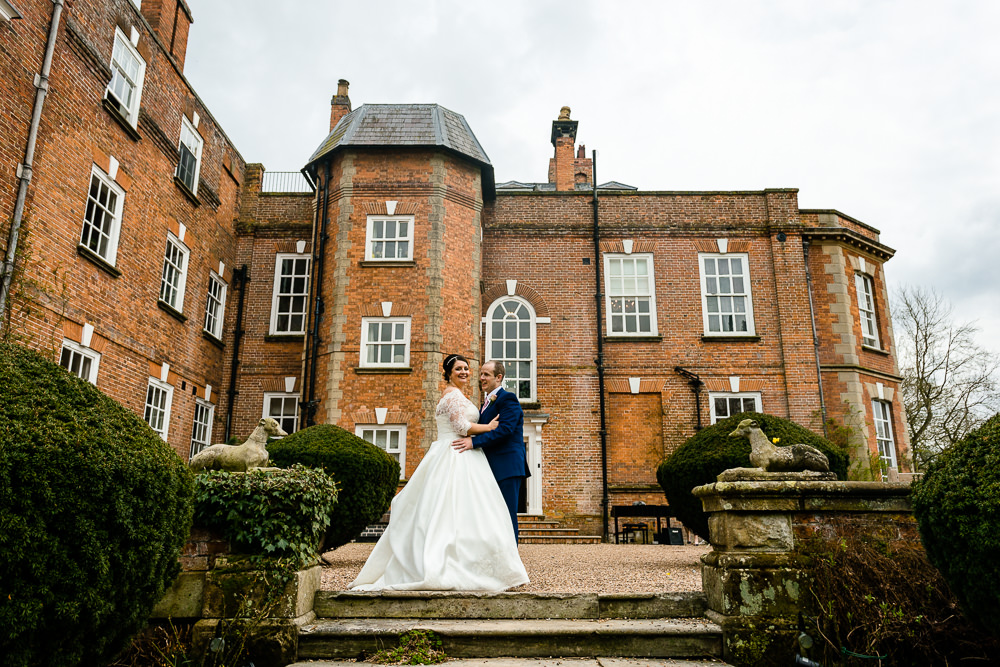A newly married couple stood in the grounds of Iscoyd Park house