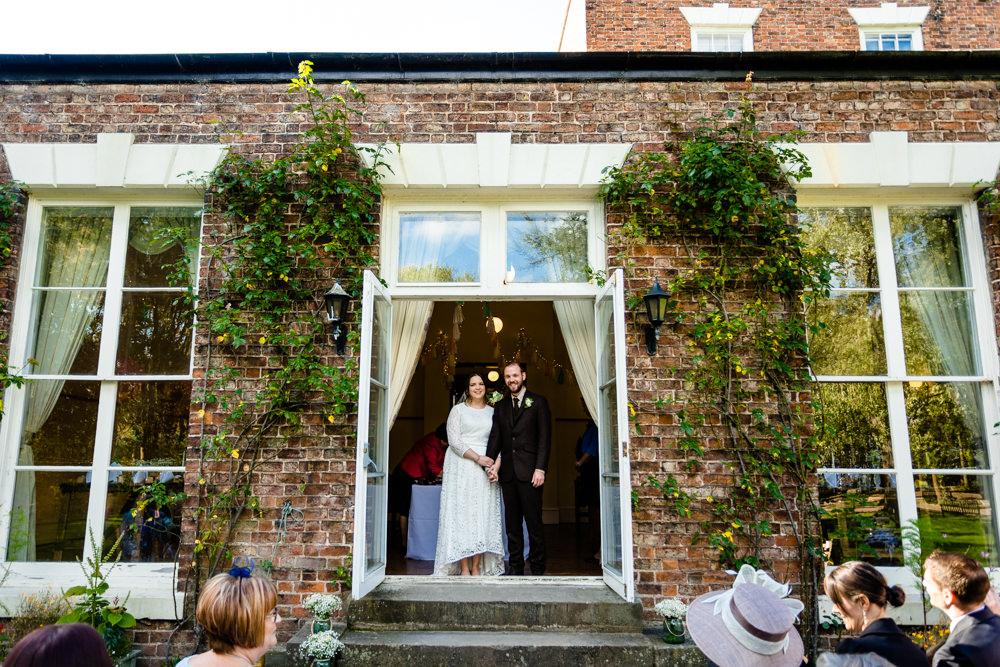 An outdoor wedding ceremony in Chester wedding venue, Trafford Hall.