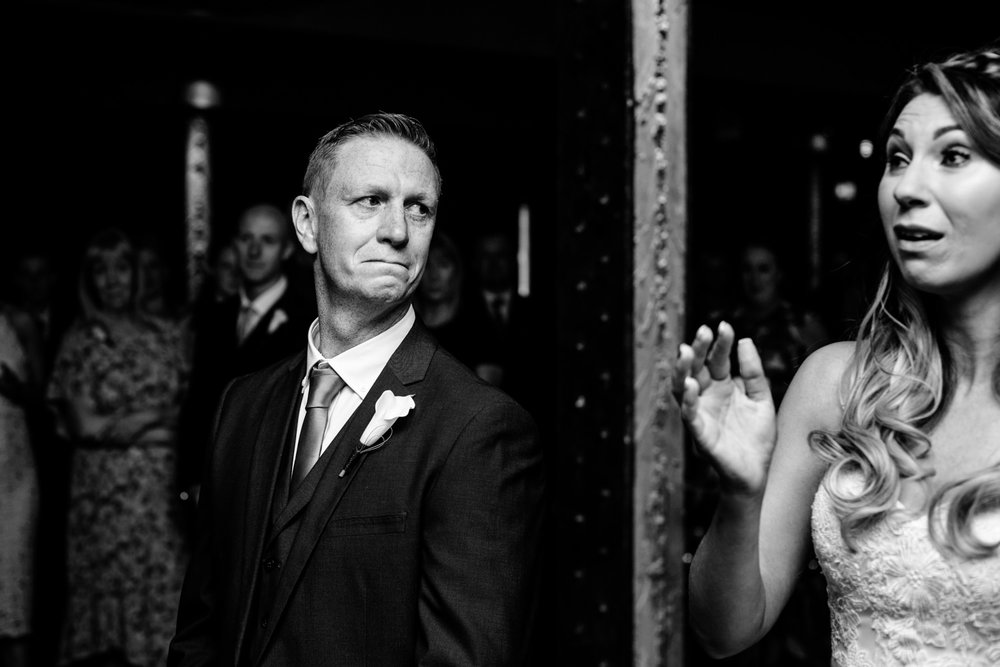 A emotional bride and groom during their ceremony.