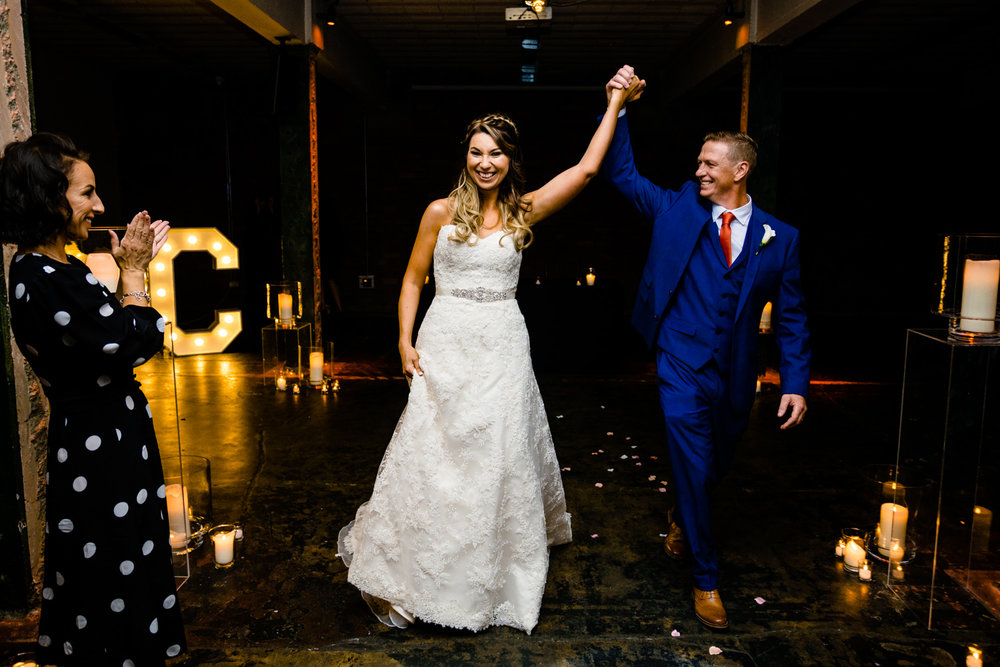 A bride and groom celebrate being married.