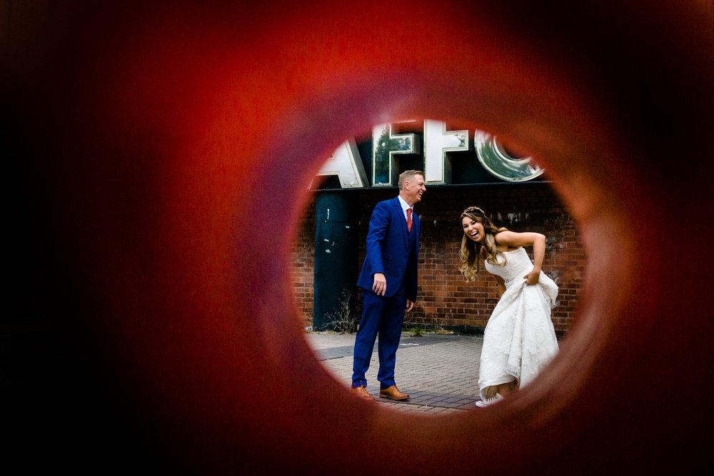 Fun couple shoot photo through a traffic cone, Victoria Warehouse wedding photos