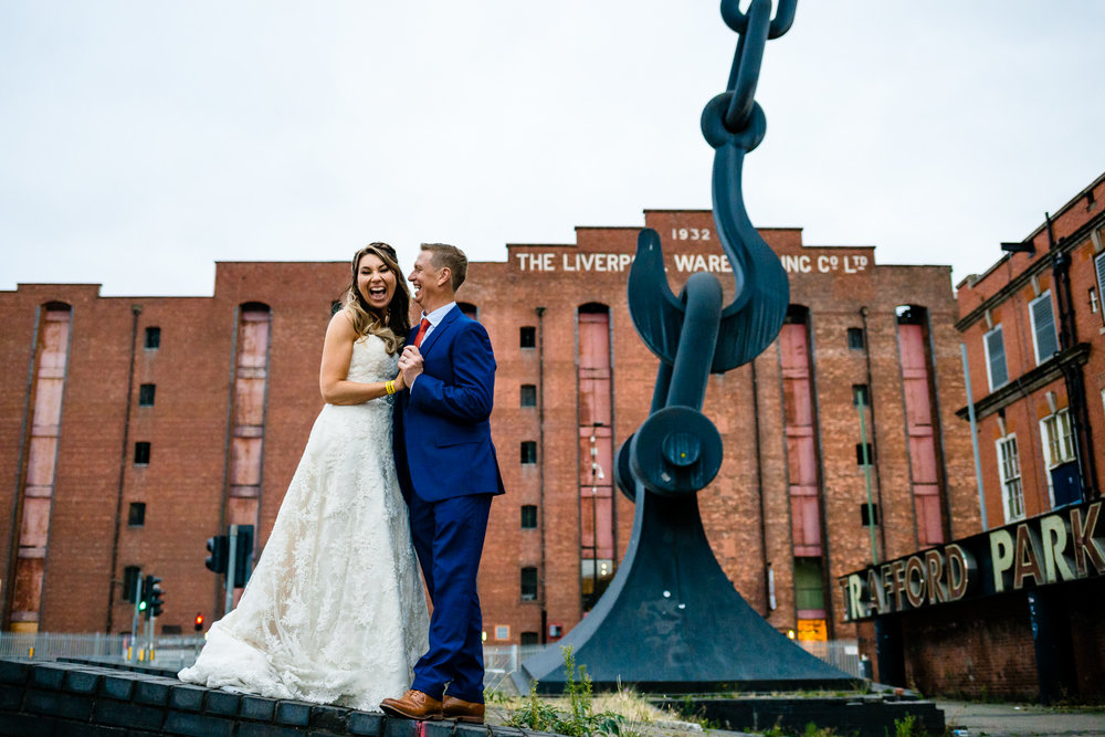 A couple laughing together, wedding photography Victoria Warehouse