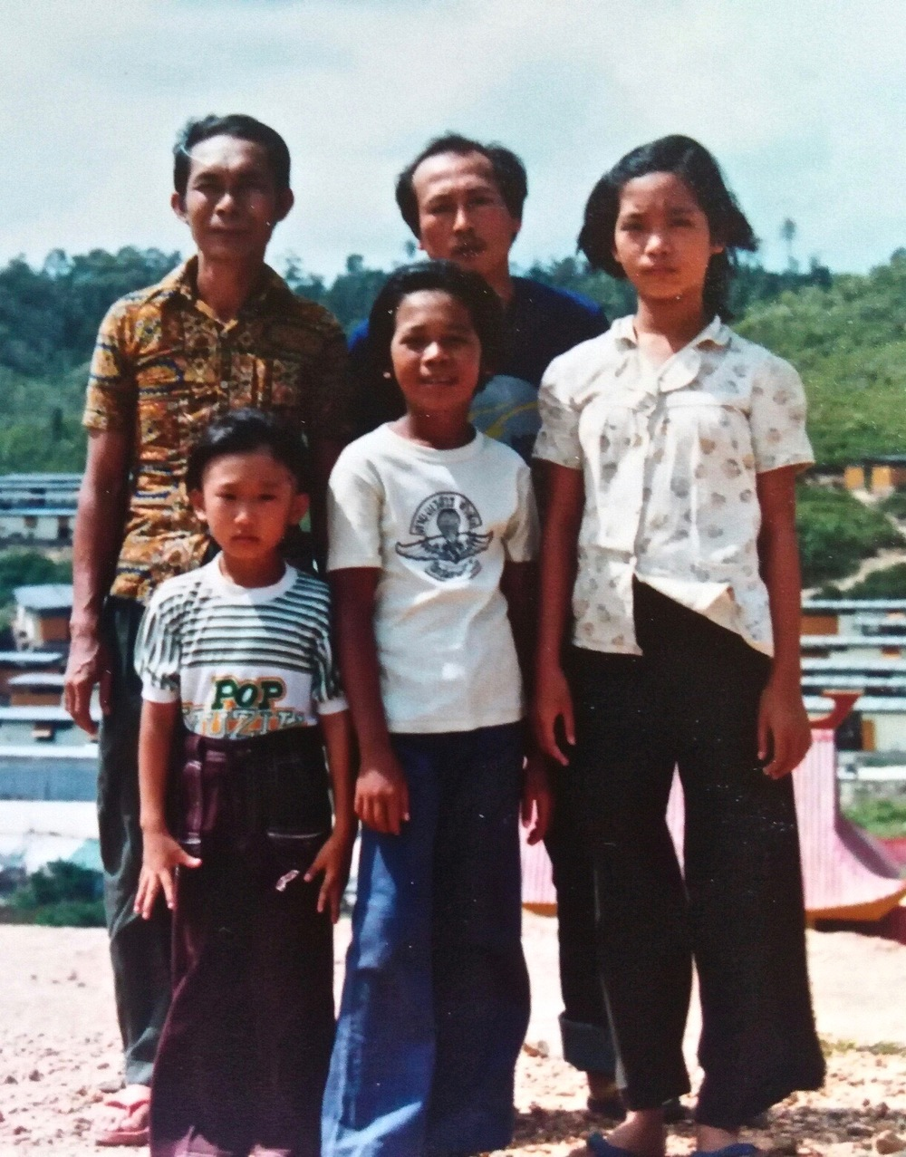 A family photo taken in the Galang Camp. From left to right: my dad, my cousin, Tom, my Uncle Ta, and me.