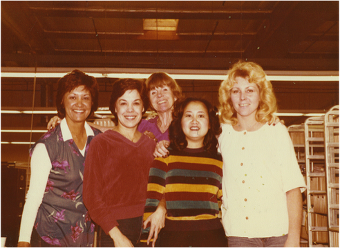 With her co-workers at one of her early jobs.