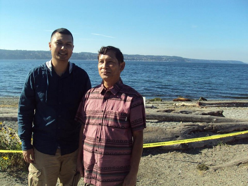 The awkward picture of me at 23 years old and my father when he visited on September 23rd, 2017. P.S. The yellow tape was to prevent passerby from touching the seal in the background in case you were wondering.