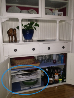 Cabinet after - shoe shelf adds storage!