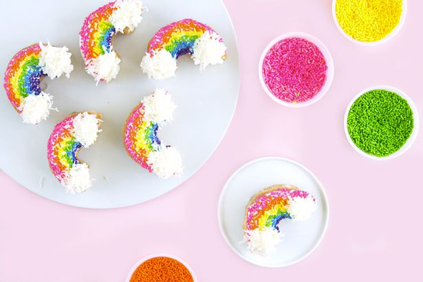 These rainbow iced donuts are brilliant - and we bet they taste nice too