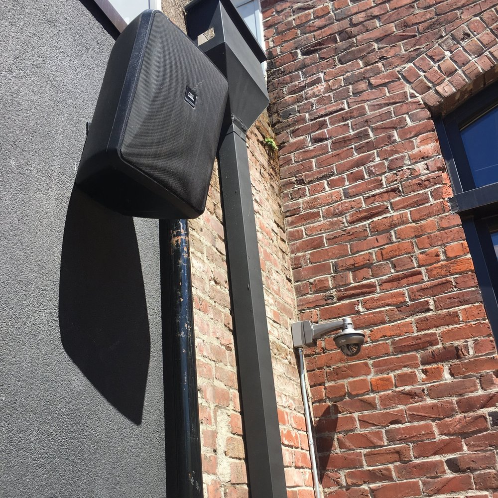 Close up of outdoor speakers and surveillance system