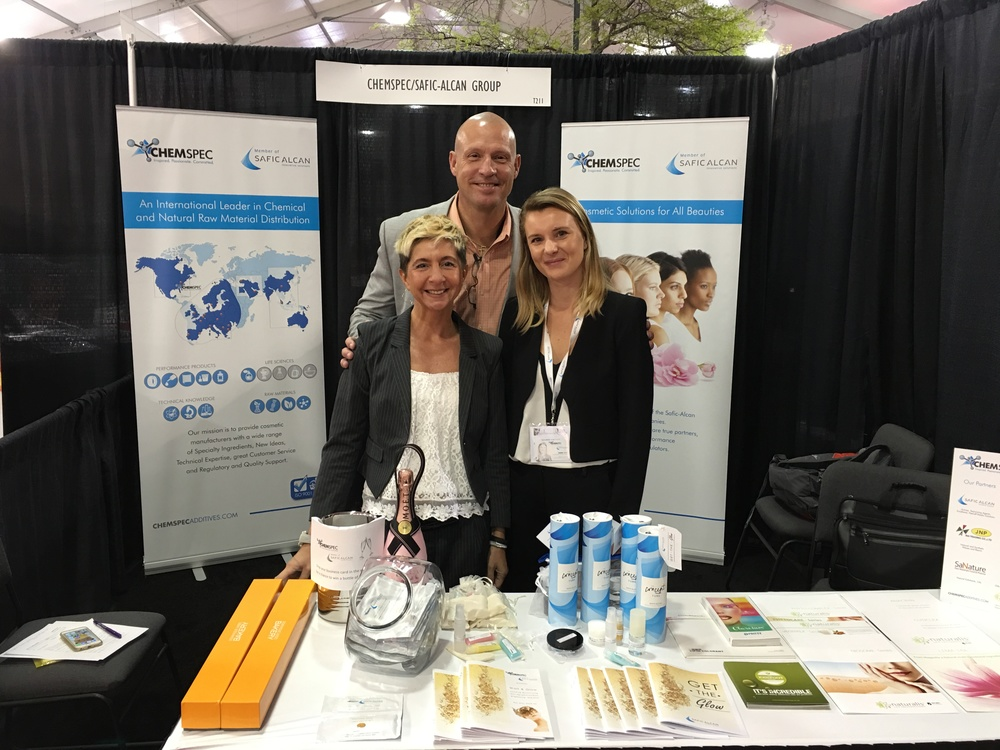 ChemSpec & Safic-Alcan Cosmetics Team Members at the NYSCC Booth: ChemSpec President Dave Moreland (Back), Safic's Valerie Laseraz (L), ChemSpec's Marie Graët (R)