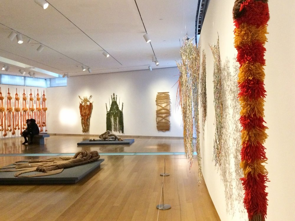 Installation view of   Françoise Grossen Selects   at Museum of Arts and Design, New York. The flames of yarn in the foreground are by my dissertation artist, Claire Zeisler!