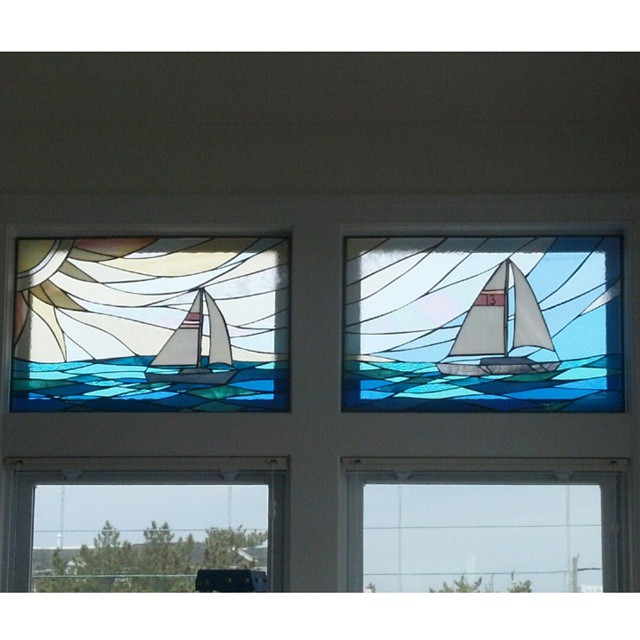 Two stained glass panels installed together to create one scene.