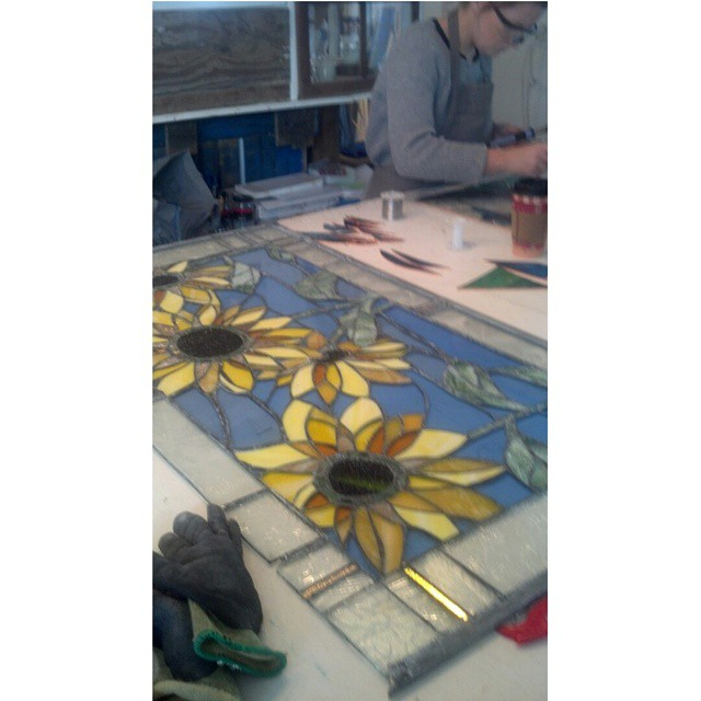 Working in the studio on this custom sunflower panel which will be hung outside on a this clients porch.