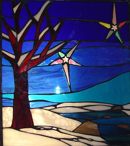 """Winter Warmth""  Stained Glass  Created for a wedding present for a couple in Jackson Hole, WY. There are two editions of this panel. The other belongs to a couple in Haddonfield, NJ.  Designing and fabrication typically are all done in our studio located on Long Beach Island, NJ. Custom work is one of our specialties, evidenced by our many happy repeat clients. We have a team of carpenters working with us for all your installation needs as well."