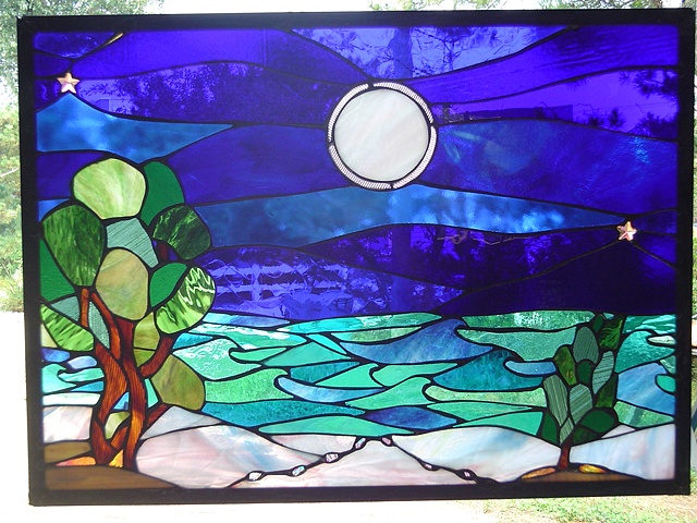 Blue Moon  Stained Glass  Now part of the R. Balzamma collection. Originally designed as an anniversary gift.  Designing and fabrication typically are all done in our studio located on Long Beach Island, NJ. Custom work is one of our specialties, evidenced by our many happy repeat clients. We have a team of carpenters working with us for all your installation needs as well.