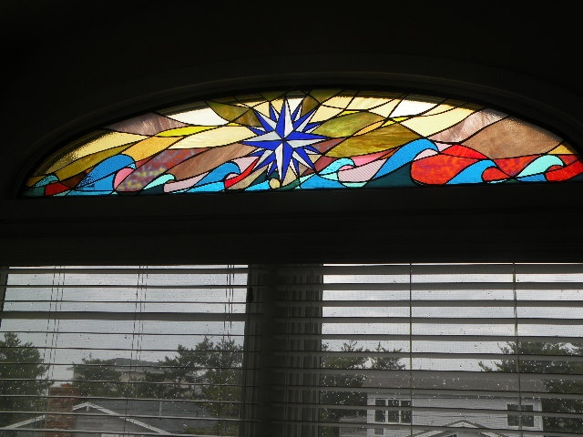 "Compass Rose of Cedars  stained glass  61"" x 17""  The compass rose is a tool used by ancient mariners to navigate the stormy and calm seas to find faraway lands and then guides them safely back home."