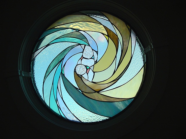 Yin Yang  Stained Glass  This round window is a focal point when inside the house. It compliments the warm colors and philosophy of the home owners.  Held in private collection in Peahala Park, NJ  Designing and fabrication typically are all done in our studio located on Long Beach Island, NJ. Custom work is one of our specialties, evidenced by our many happy repeat clients. We have a team of carpenters working with us for all your installation needs as well.