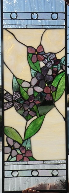 Kitchen Cabinet  Stained Glass  Custom cabinetry for a private residence. The cabinets have interior lighting, so this panel has a soft glow.  Designing and fabrication typically are all done in our studio located on Long Beach Island, NJ. Custom work is one of our specialties, evidenced by our many happy repeat clients. We have a team of carpenters working with us for all your installation needs as well.