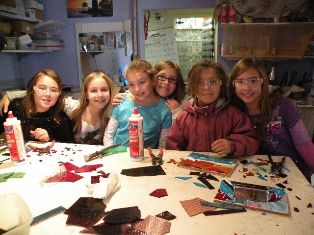This picture shows girl scouts making mosaic wall art.