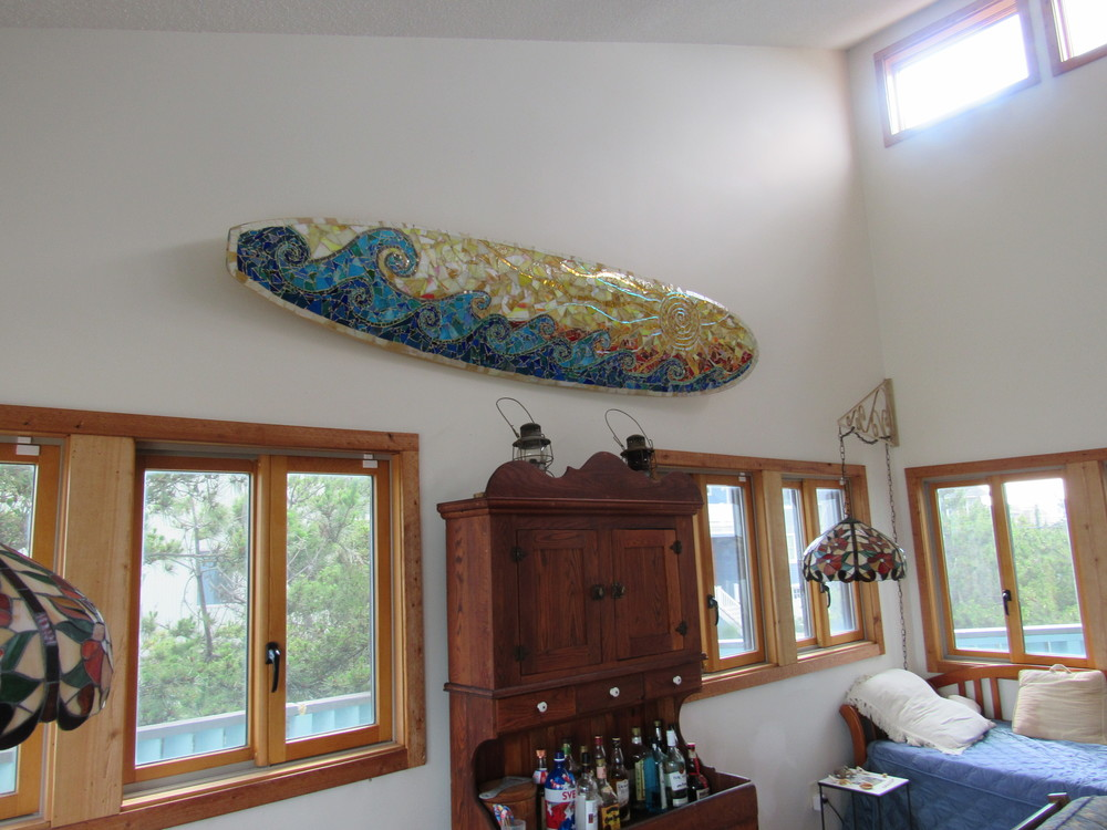 Beautiful custom surfboard mosaic in its home sweet home