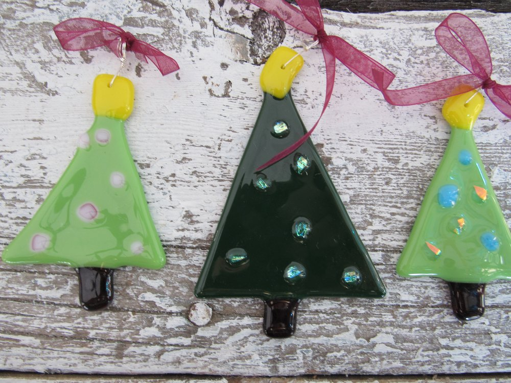 Santa's Workshop at SwellColors - Make 3 fused glass ornaments for your tree. This is a walk in class and takes about an hour for most people.   This is a perfect gift for the hard to buy for people in your life and is a super fun way to spend some time this holiday season. Take a break from the hustle and bustle and give yourself some art therapy. :-) These fire overnight in our kiln and are available for pick up a day or two later. OR if you need us to ship them for you, we can do that too. Cost is $50 per person. Available everyday until December 25th, 2016!