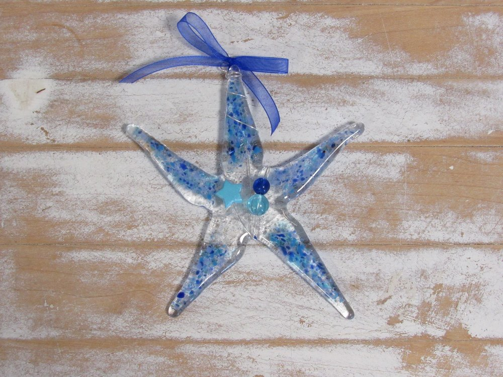 Or perhaps you just want to get Mom a Wish Upon a Star Ornament to show her how fabulous she is. Each contains a sprinkle of sand from a place you love!
