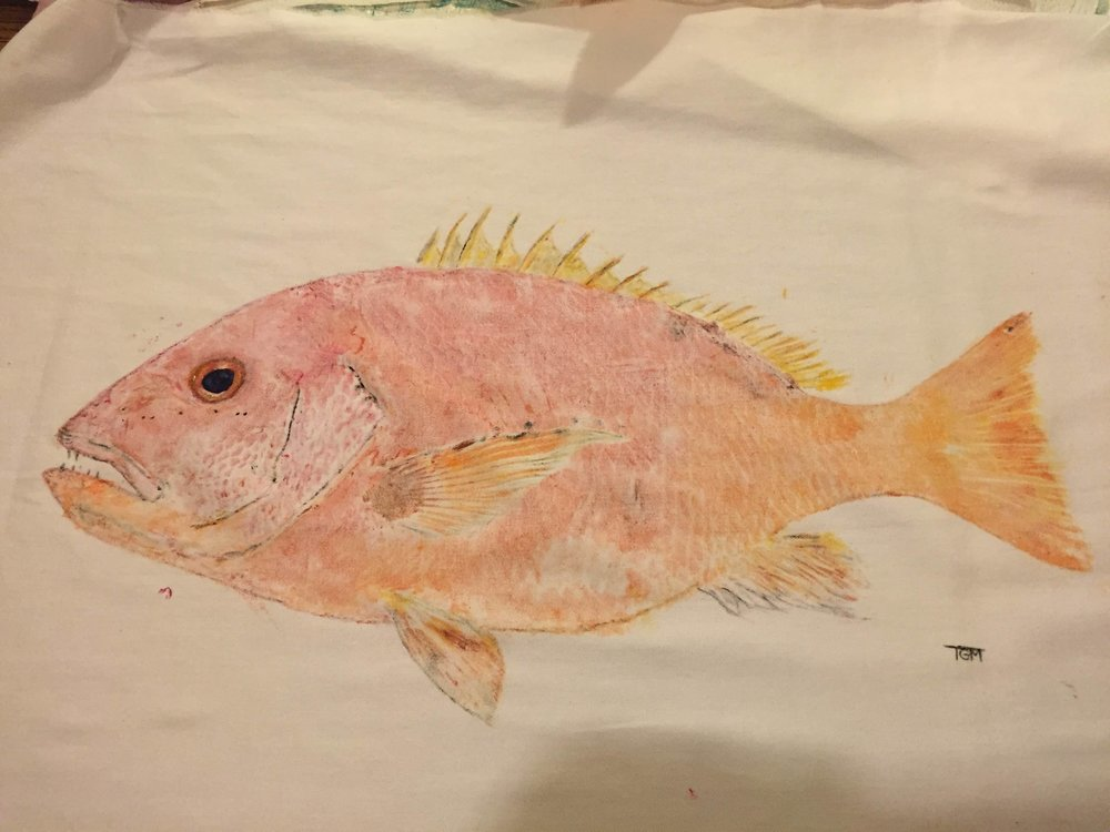 A red snapper- made by painting ink directly onto the fish and pressing it to the surface of fabric. A very cool gift for dad this Father's Day.
