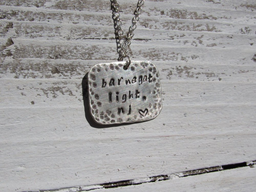 Pictured here is a metal stamped pendant you can make in this easy and fun class. Show up with a simple phase, word, or idea to stamp onto your pendant.