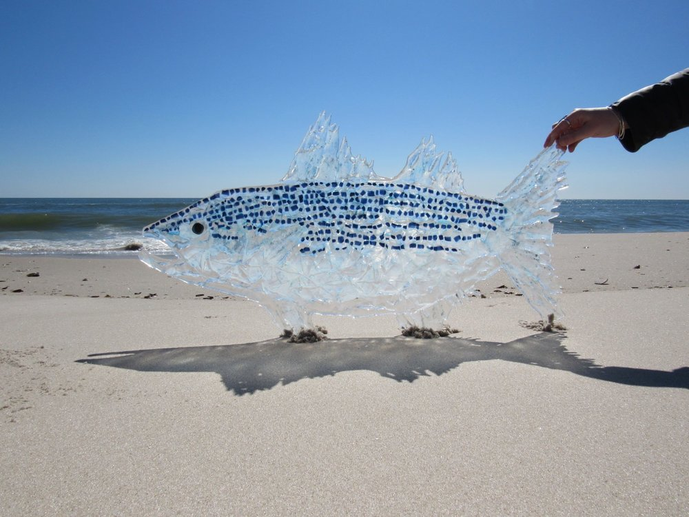 This huge glass fish was made from upcycled glass pieces fired in our kiln.