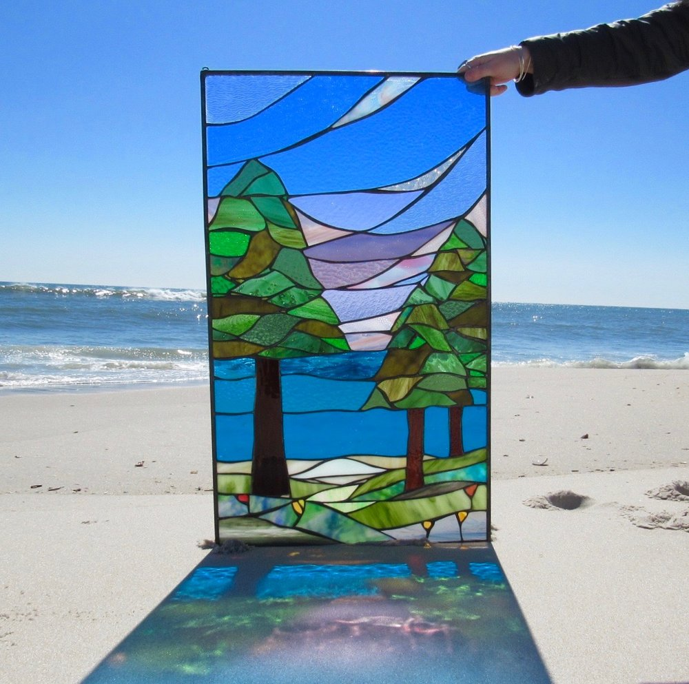 Handmade custom stained glass panel by SwellColors owner and artist, Mary Tantillo. 2018.