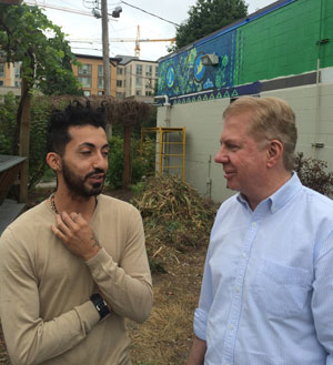 Artist Adream de Valdivia describing his new civic mural in Cascade to Seattle Mayor Ed Murray during a Find It, Fix It walking tour in July.
