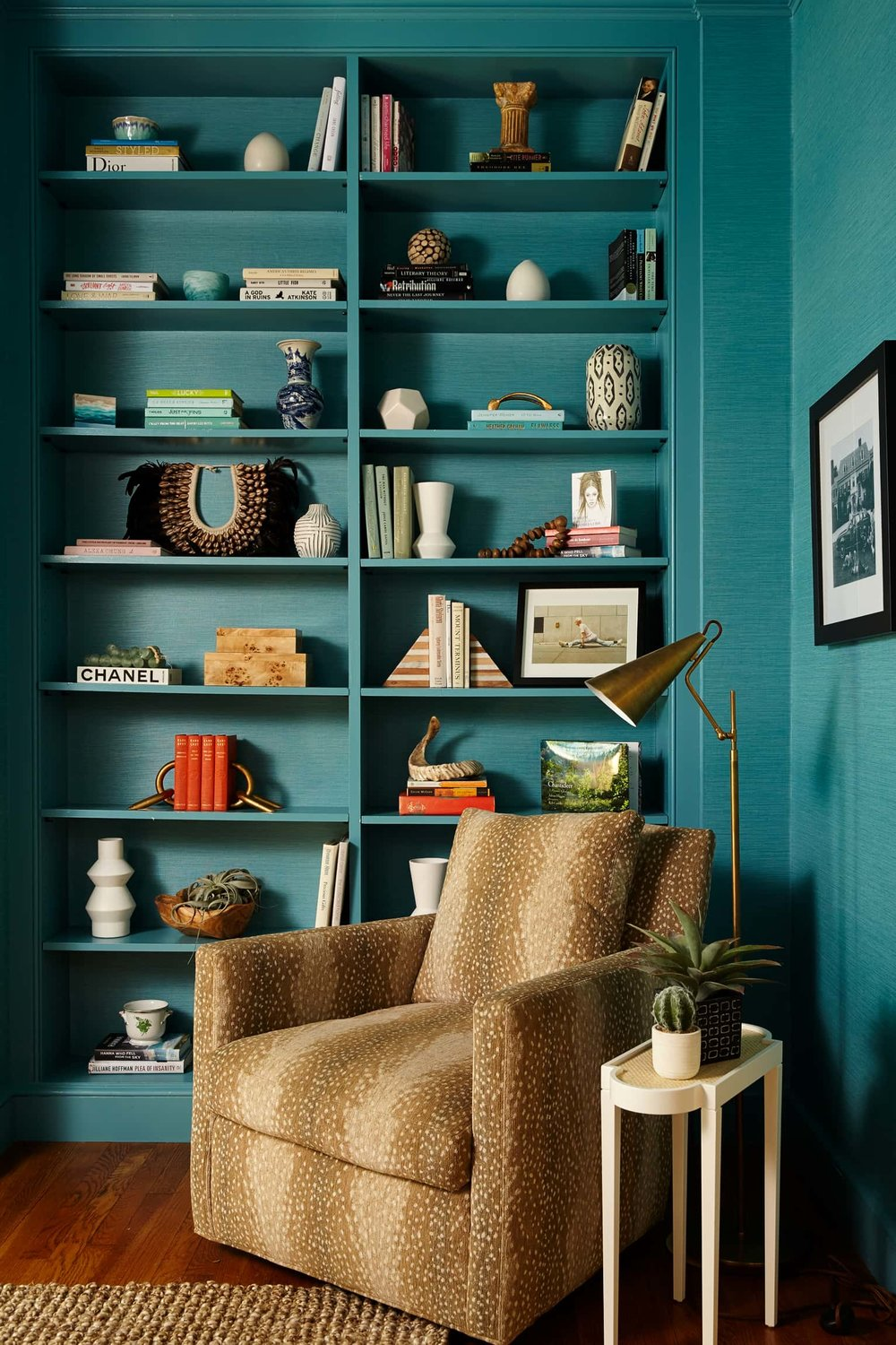 Living room with shelves and a chair