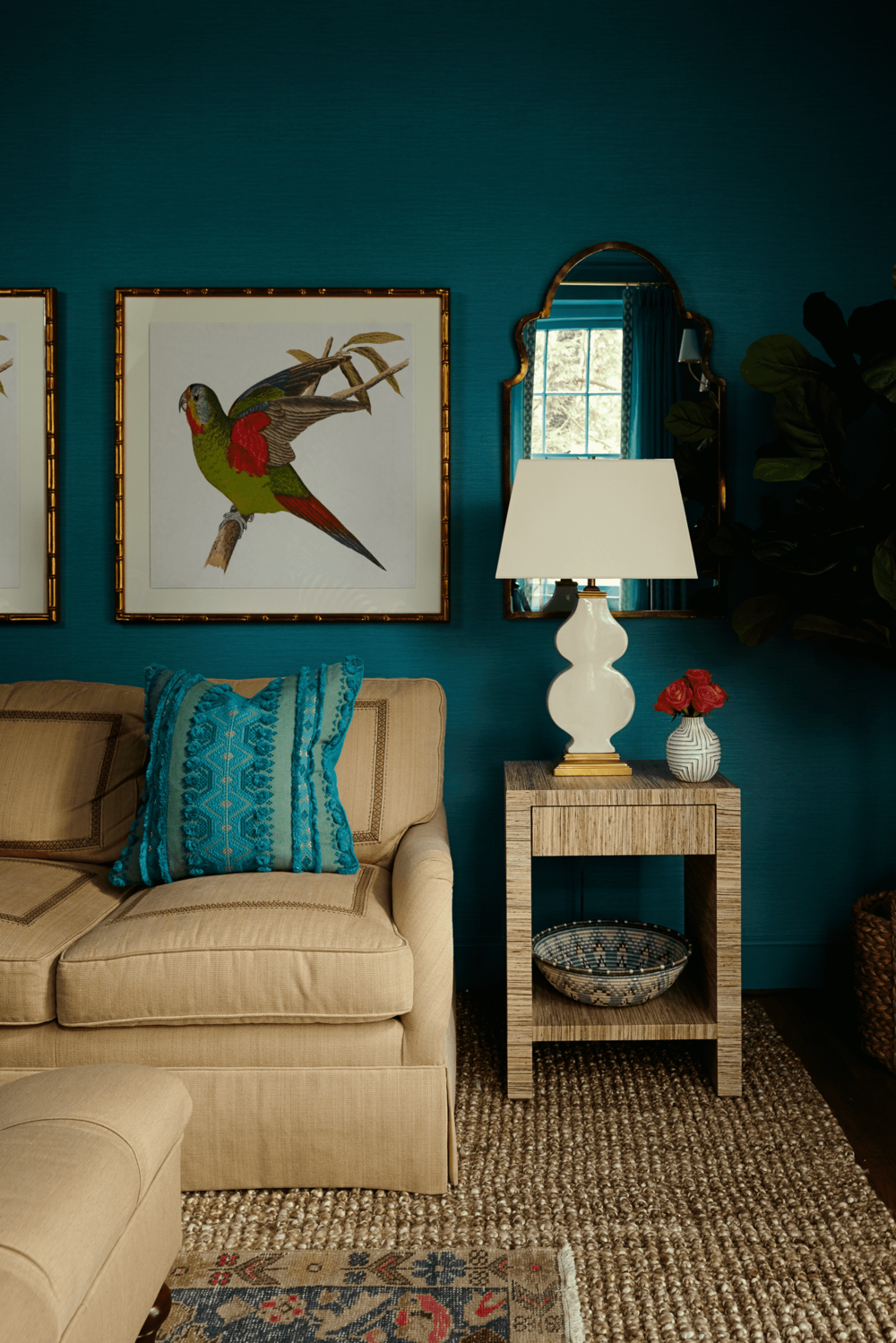 Living room with sofa and a picture of a bird