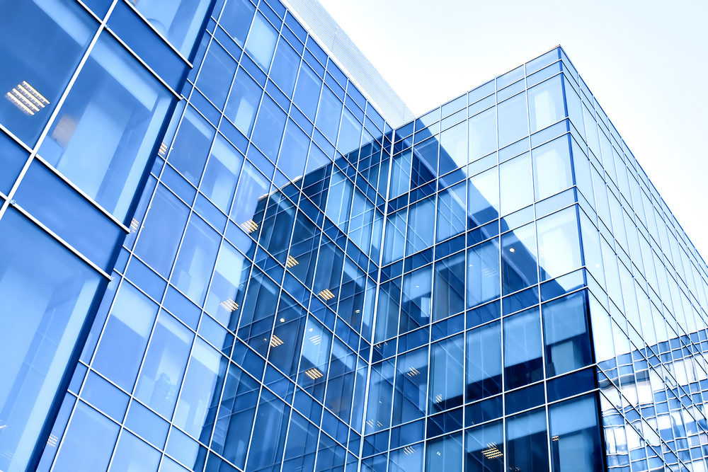bigstock-blue-modern-business-buildings-18517436.jpg