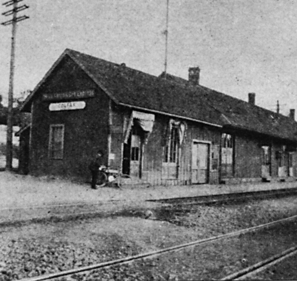 Wyman's photograph of at the Colfax Depot, near the Donner Summit with his bike leaned against the station.