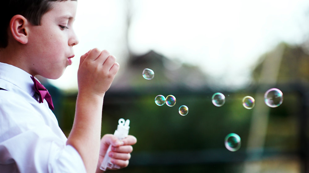 The act of blowing bubbles has a lot of benefits. Along with delight, breathing is one. Photo courtesy of unsplash.com