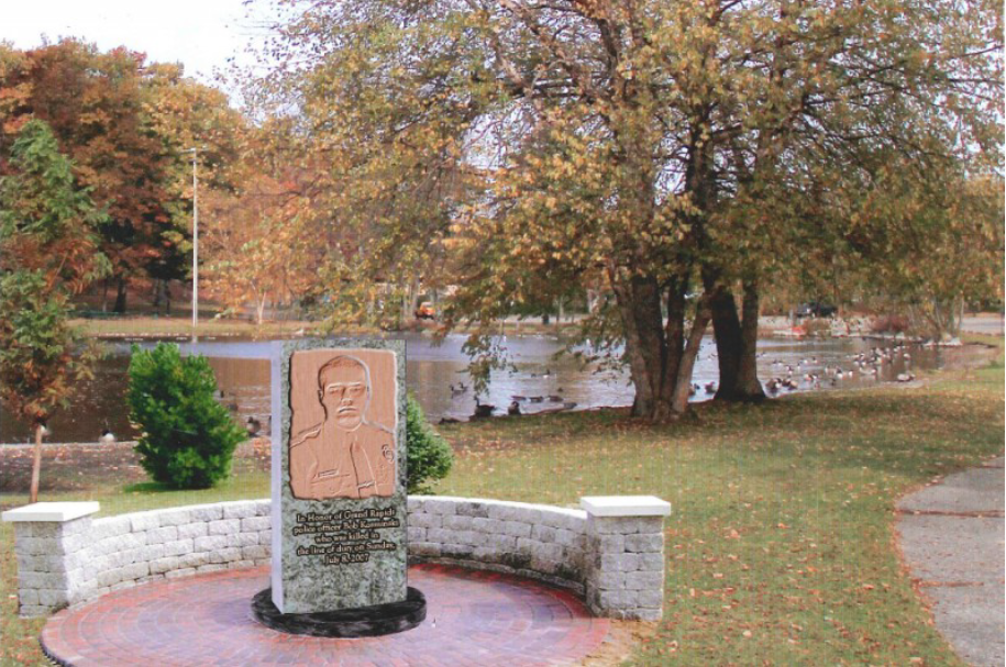A rendering of what the memorial might look like in Richmond Park. The front will have Officer Bob Kozminski on it and the back will have the rest of the fallen Grand Rapids Police Officers on it.