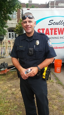 WGNO Community Police Officer Leonard at the Steepletown Preschool playground build.