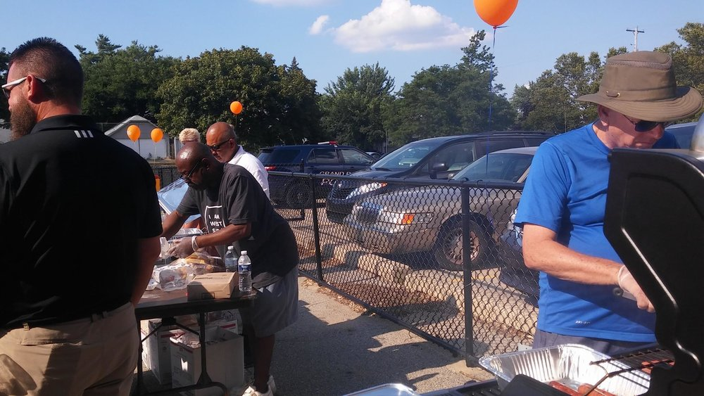 - Awesome volunteers at National Night Out 2016 making hot dogs that were donated for the event by Kent Quality Meats!