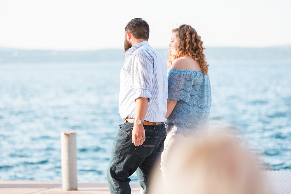 Romantic Petoskey Michigan Proposal on the Pier   How He Asked   She Said Yes   Laurenda Marie Photography