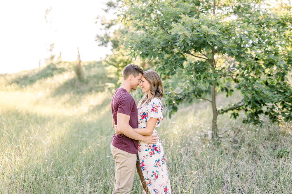 Beautiful Summer Shoreline Engagement Session on Lake Michigan | Beach Engagement | Laurenda Marie Photography | What to Wear to an Engagement Session | West Michigan Wedding Photographer