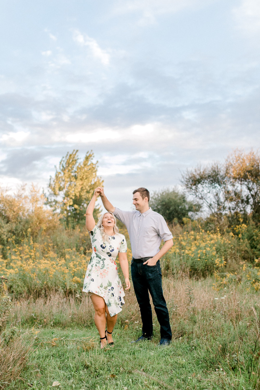Summer engagement session | Wildflowers | Field engagement session | Floral Engagement Dress | West Michigan Wedding Photography