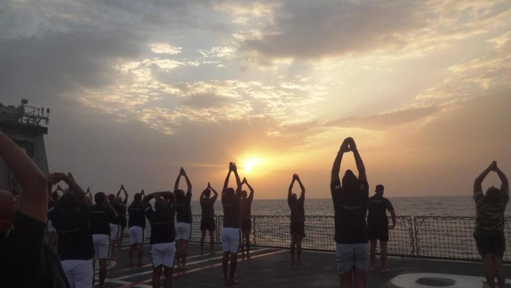Indian Navy personnel perform yoga on board INS Satpura in 2015