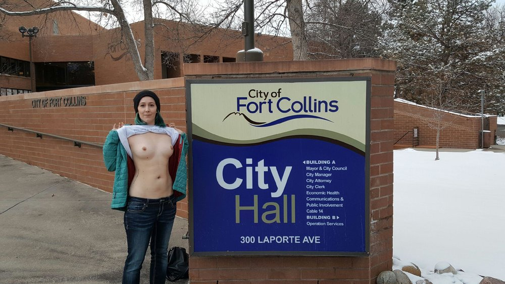 Plaintiff Samantha Six, on the day of the injunction, exercising her constitutional in front of the Fort Collins City Hall sign. 2/22/17