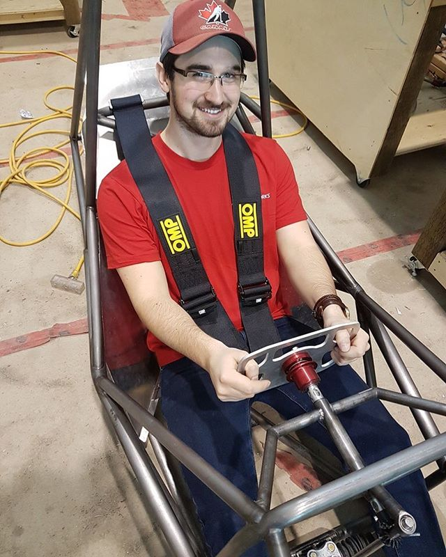 Chassis team member Jordan helping to finalize the positioning and mounting for our new @ompracing harness.